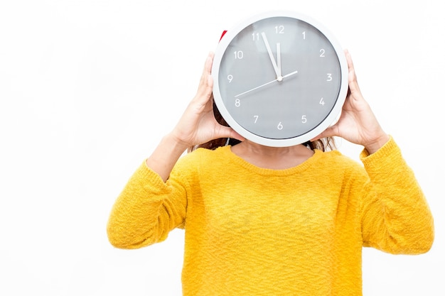 Woman covering face with watch