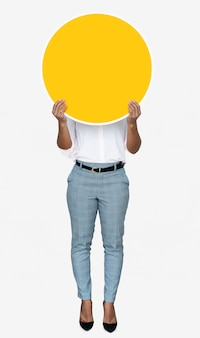 Woman covering her face with a yellow board