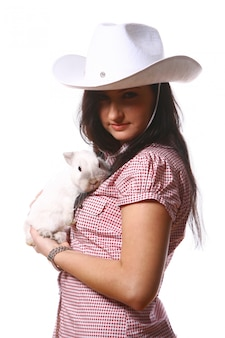 Woman cowgirl with bunny