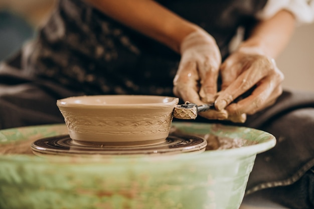 Woman craftmaster at a pottery shop