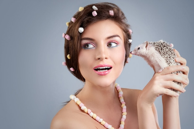 Woman in creative image with marshmallow with hedgehog