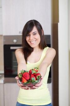 Woman cutting strawberries