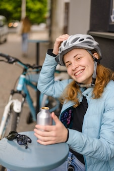 Woman cyclist in a helmet smiling
