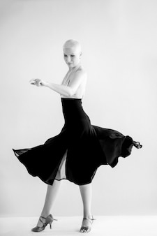 Woman dancing ballet in black and white photo