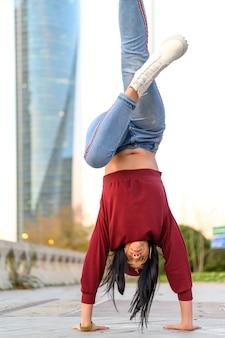 Woman dancing breakdance in the street