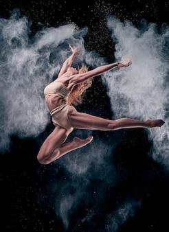 Woman dancing in a cloud of flour