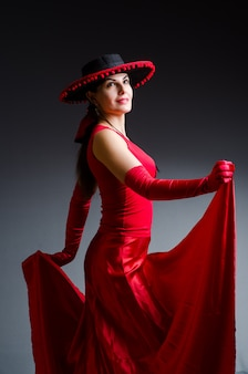 Woman dancing dances in red dress