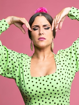 Woman dancing flamenco with eyes closed