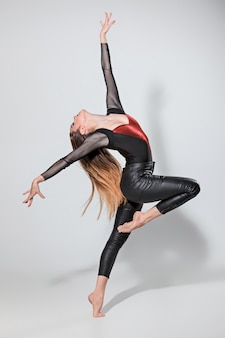 The woman dancing on gray