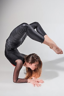 Woman dancing on gray