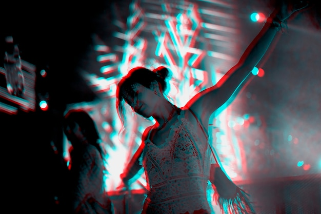 Woman dancing in a music festival in double color exposure effect