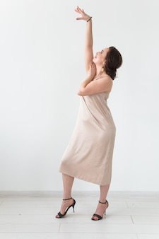 Woman dancing in white dress