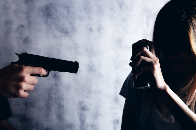Woman defend herself with a spray can from an armed man