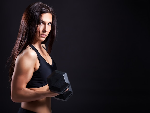 Woman demonstrates biceps