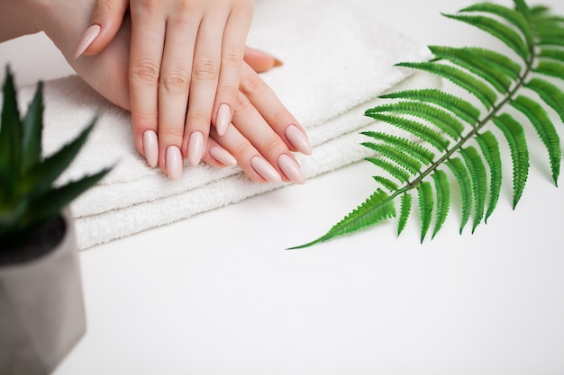 Woman demonstrates a fresh manicure