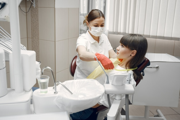 Woman in a dental chair. girl is examined by a dentist.beauty treats her teeth