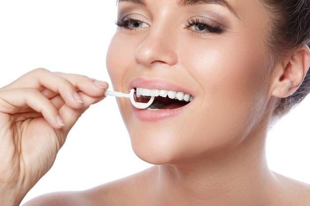 Woman and dental floss pick