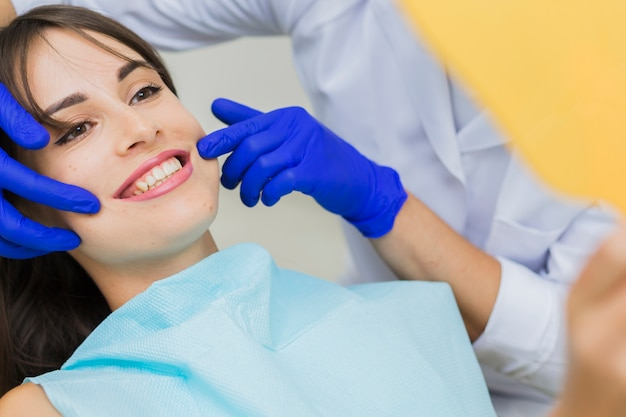 Woman at dentist smiling