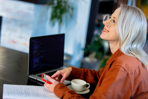 Woman developer working with computer at home office