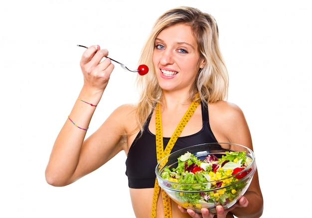Woman in diet with salad bowl