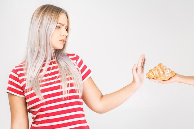Woman on dieting for good health concept. woman doing sign no to refuse junk food or fast food that have many fat.