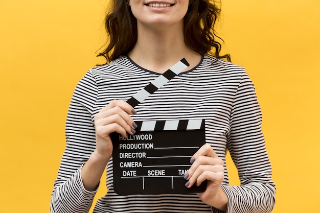 Woman director holding a clapperboard