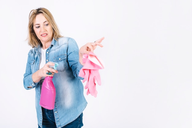 Woman disinfecting gloves