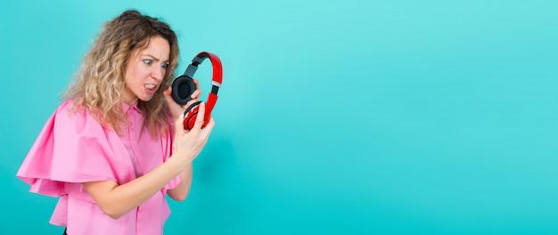 Woman dj in shirt with headphones