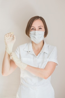 Woman doctor in gloves and medical mask
