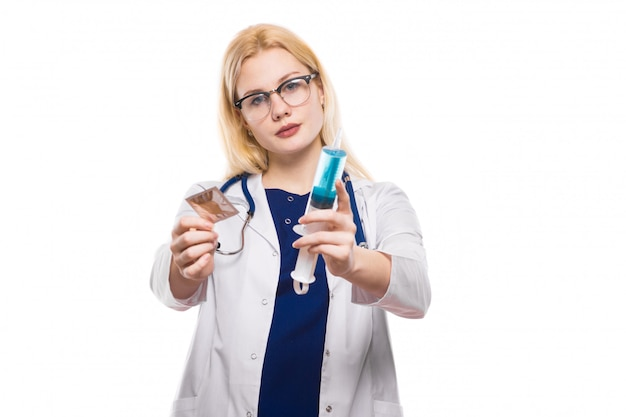 Woman doctor hold condom and injection