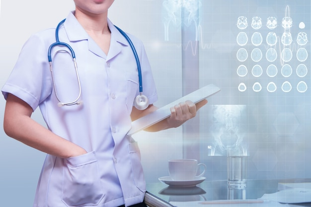 Woman doctor holding smart device