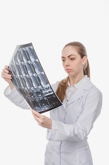 Woman doctor looking at x-ray shot
