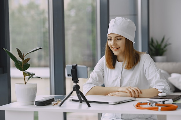 Woman doctor recording vlog video about medicin