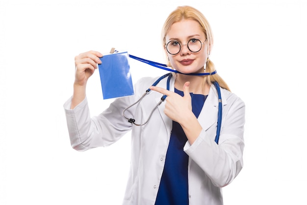 Woman doctor in white coat with badge