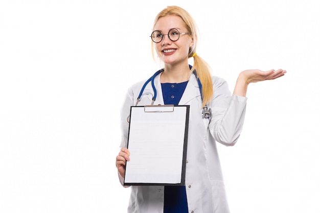 Woman doctor in white coat with clipboard