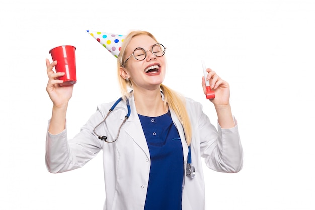 Woman doctor in white coat with party stuff