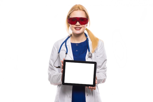Woman doctor in white coat with tablet