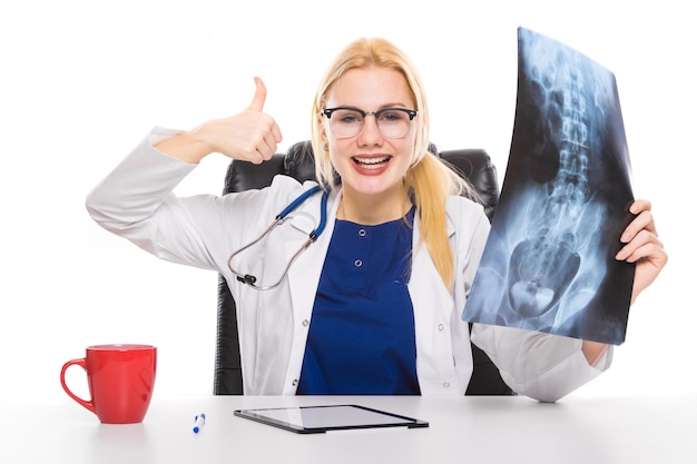 Woman doctor in white coat with x-ray