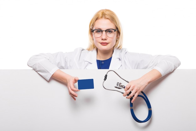 Woman doctor with stethoscope and business card