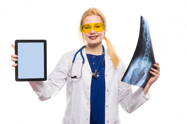 Woman doctor with x-ray and tablet