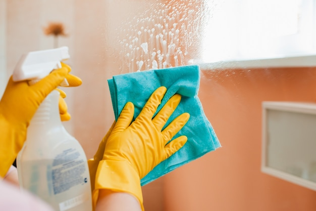 Woman does household chores at home