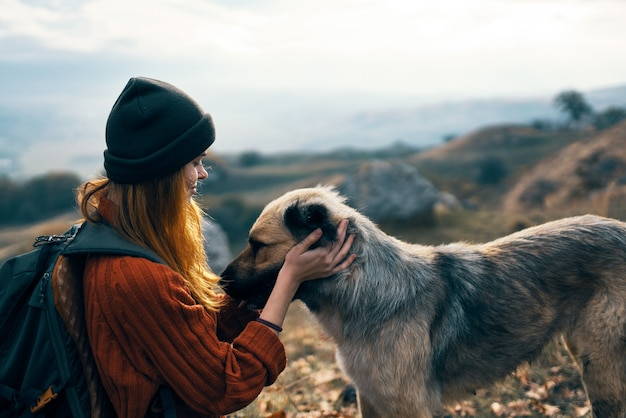 Woman next to a dog outdoors vacation friendship. high quality photo