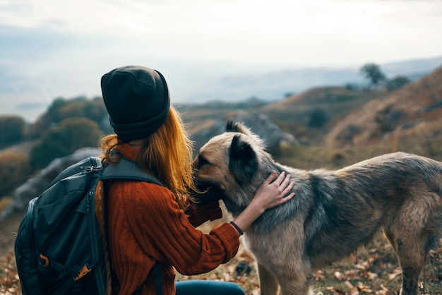 Woman next to a dog outdoors vacation friendship