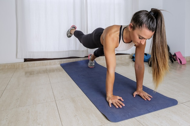 Woman doing abs plank exercise