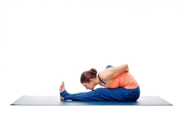 Woman doing ashtanga vinyasa yoga asana marichyasana a isolated