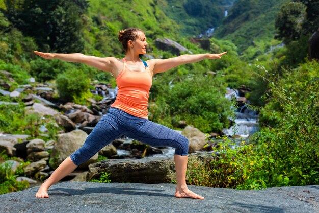Woman doing ashtanga vinyasa yoga virabhadrasana 2 warrior pose