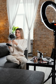 Woman doing a beauty vlog