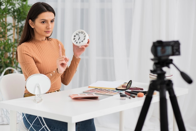 Woman doing a commercial with a clock