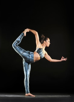 Woman doing a dancer pose during a yoga workout