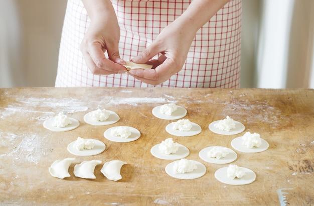 Woman doing dumplings, vareniks. handmade.